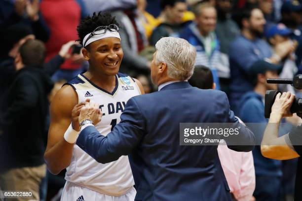 Chima Moneke of the UC Davis Aggies reacts with head coach Jim Les after defeating the North Carolina Central Eagles 6763 during the First Four game...