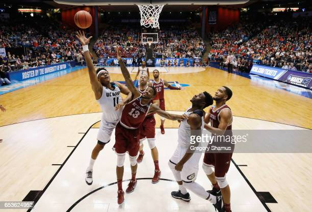 Chima Moneke of the UC Davis Aggies shoots the ball against Pablo Rivas of the North Carolina Central Eagles during the First Four game in the 2017...