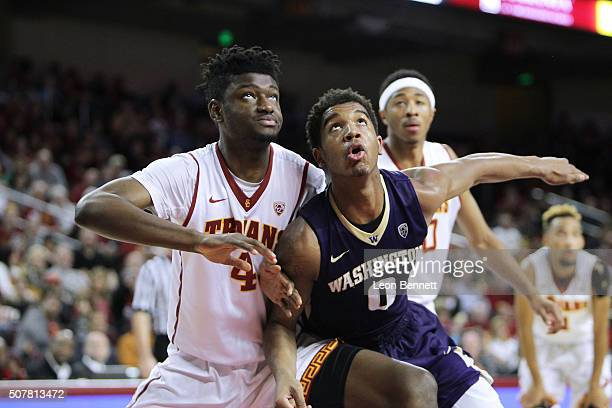 Chimezie Metu the USC Trojans battles for position during free throws against Marquese Chriss of the Washington Huskies during a NCAA college...