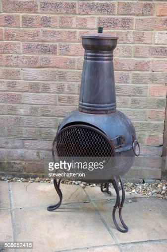 chiminea in back yard : Stock Photo