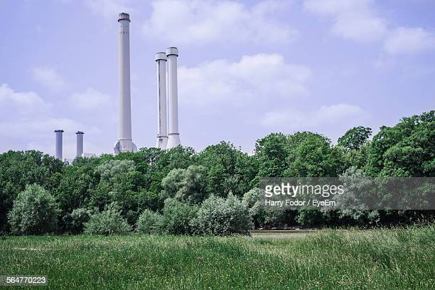 Chimney Against Sky With Trees In Foreground