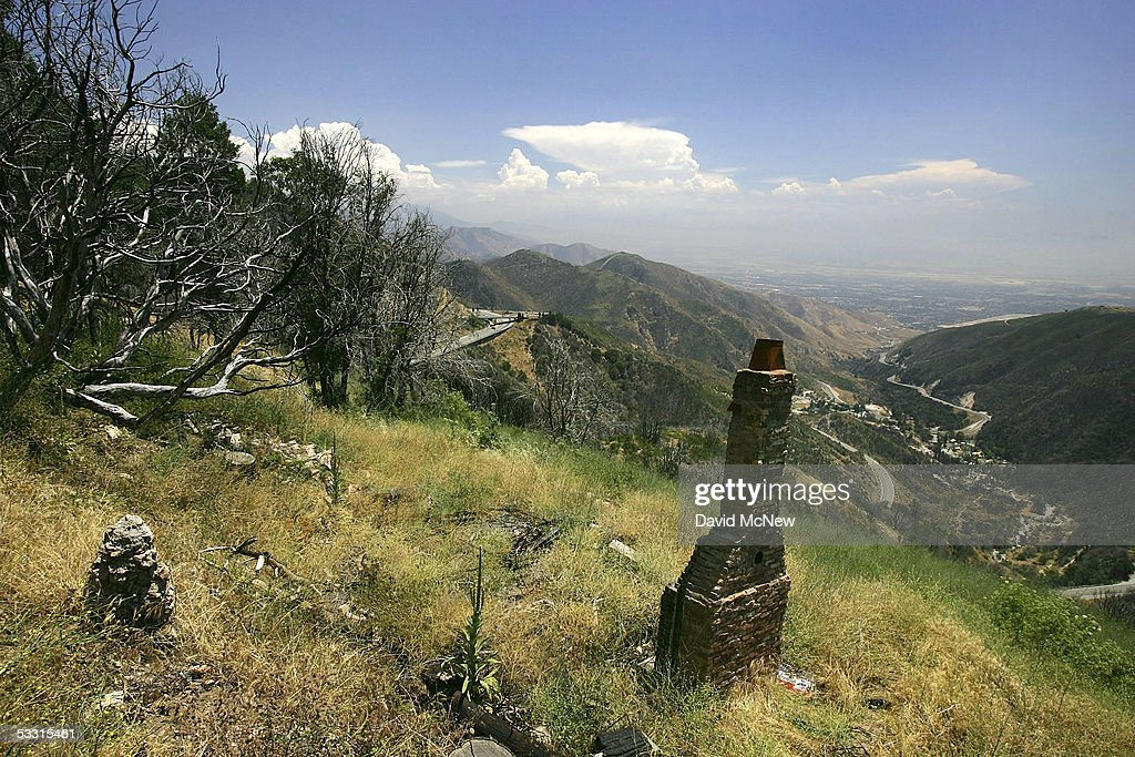 A chimney, all that is left of a house that burned during the historic 2003 wildfire season, is seen on August 1, 2005 in Running Springs, east of Lake Arrowhead, California. Last winter was one of the wettest on record, dropping 90 inches of rain in some southern California mountain areas and creating the thickest vegetation growth in memory, and damaging more than 2,000 miles of fire access roads used to protect 2.3 million acres of forests. In addition to the many thousands of trees killed by a massive pine beetle infestation, newly grown vegetation is drying up under triple-digit temperatures and raising fears of a repeat of the devastating fire season of 2003. President Bush signed an emergency funding bill in May allocating $25 million to fix roads in southern California?s national forests but Congress has acted slower than expected in providing the money so some of the repairs might not be done until October.