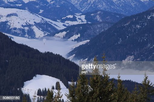 Chimney in the clouds, European Alps pollution or? : Stock Photo