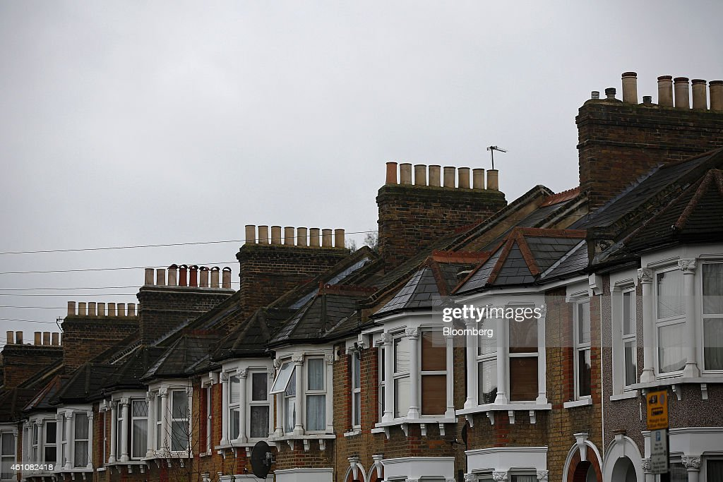 Chimney Pots Line The Rooftops Of Houses In The Catford