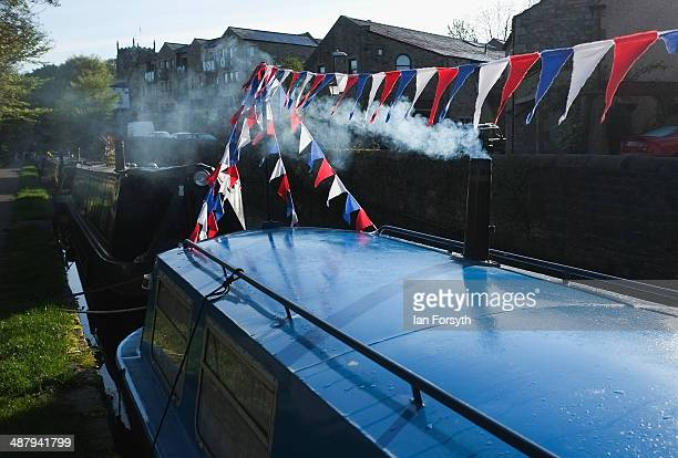 A chimney smokes in the early morning on a canal boat during the Skipton Waterway Festival on May 3 2014 in Skipton England The Waterway festival is...