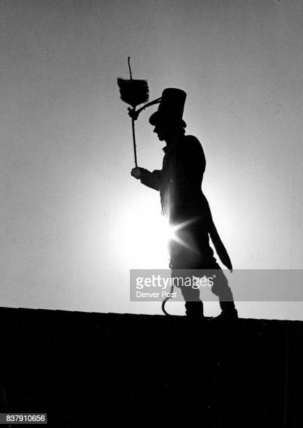 Chimney Sweep Silhouetted Against Sun Draws Much Attention In Aurora Credit The Denver Post