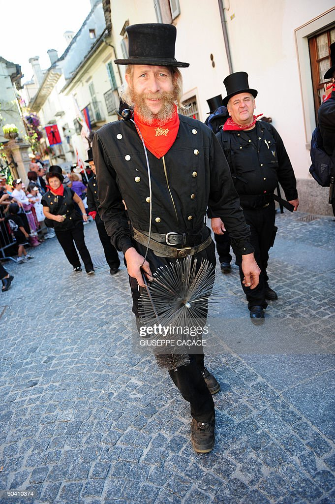 A chimney sweeper walks during a parade as part of the ...