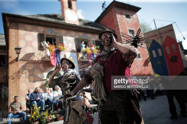 Chimney sweeps shout during a parade as part of the 33th International Meeting of Chimney Sweeps in the small village of Santa Maria Maggiore in the...