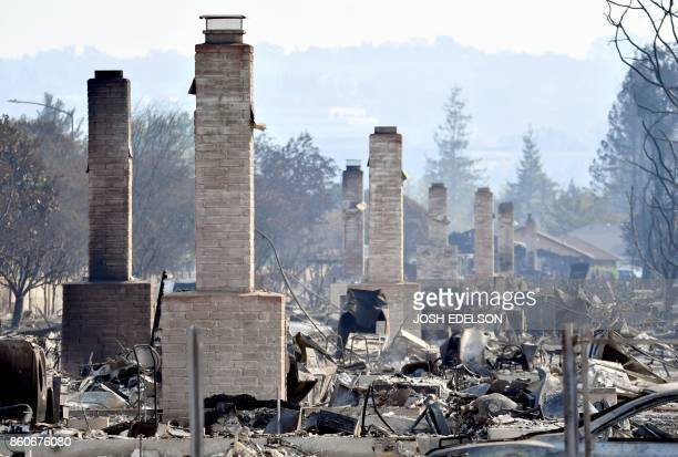 Chimneys are all that remain standing amidst a swath of burned out properties in Santa Rosa California on October 12 2017 Hundreds of people are...
