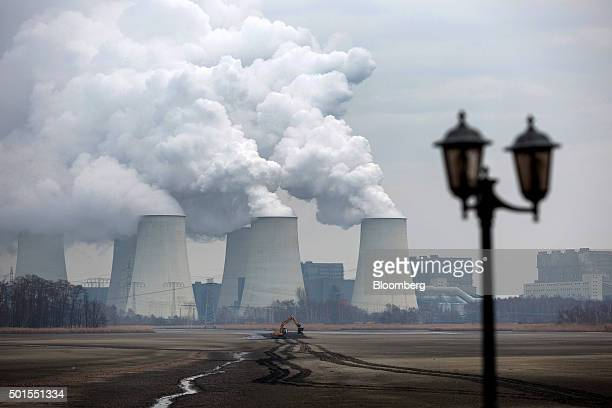 Chimneys emit vapor at Jaenschwalde lignite power plant operated Vattenfall AB in Peitz Germany on Tuesday Dec 15 2015 Global governments and...