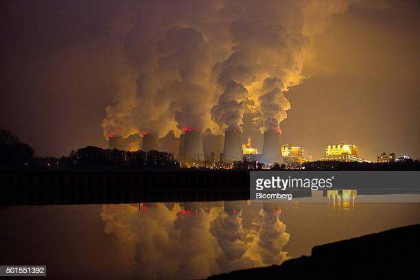 Chimneys emit vapor at Jaenschwalde lignite power plant operated Vattenfall AB at dusk in Peitz Germany on Tuesday Dec 15 2015 Global governments and...