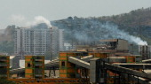 Chimneys from Indian factories are pictured at an industrial area in Mumbai on June 4 on the eve of World Environment Day India's cities are becoming...