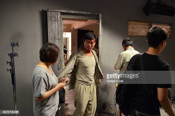Chin Siuho centre with crew on the Hong Kong film set of Rigor Mortis a horror film about vampires The film is Juno Mak's directorial debut and is...