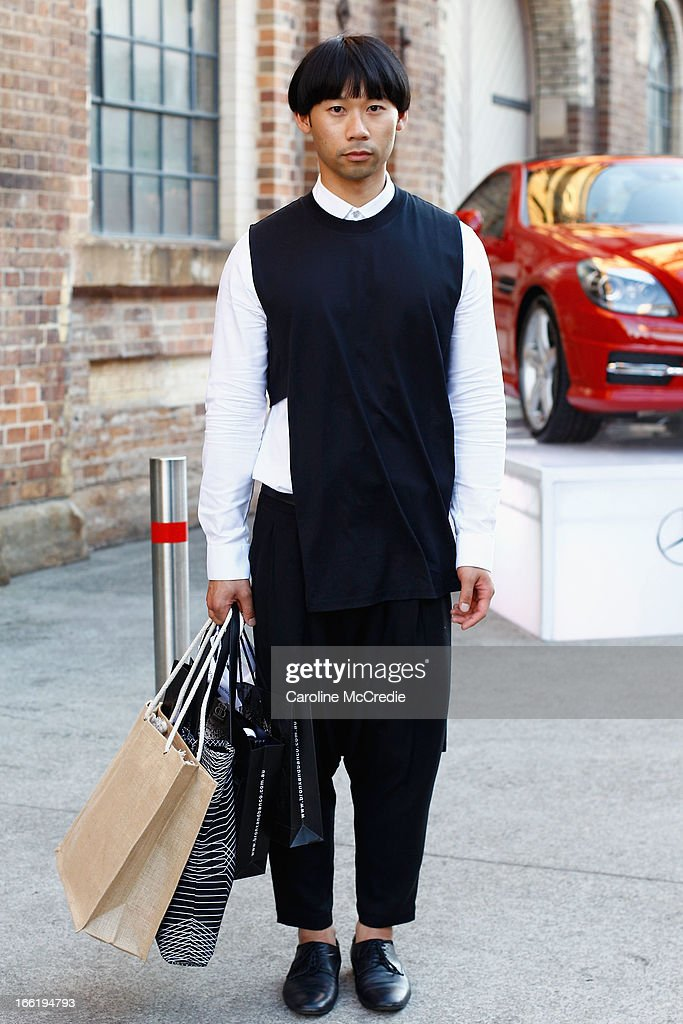 Chin Tay wears a Shvonski singlet, Topman shirt, Jimmy D pants and Country Road shoes at Mercedes-Benz Fashion Week Australia Spring/Summer 2013/14 at Carriageworks on April 10, 2013 in Sydney, Australia.