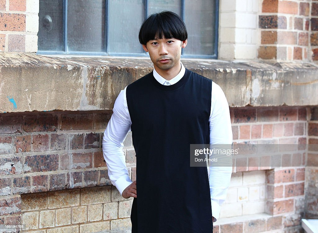 Chin Tay wears a singlet by Givenchy and shirt and pants by Topman at Mercedes-Benz Fashion Week Australia Spring/Summer 2013/14 at Carriageworks on April 10, 2013 in Sydney, Australia.