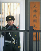 BEIJING China A police officer stands guard in front of the South Korean Embassy in Beijing on Dec 14 2011 On the previous day the embassy was hit by...