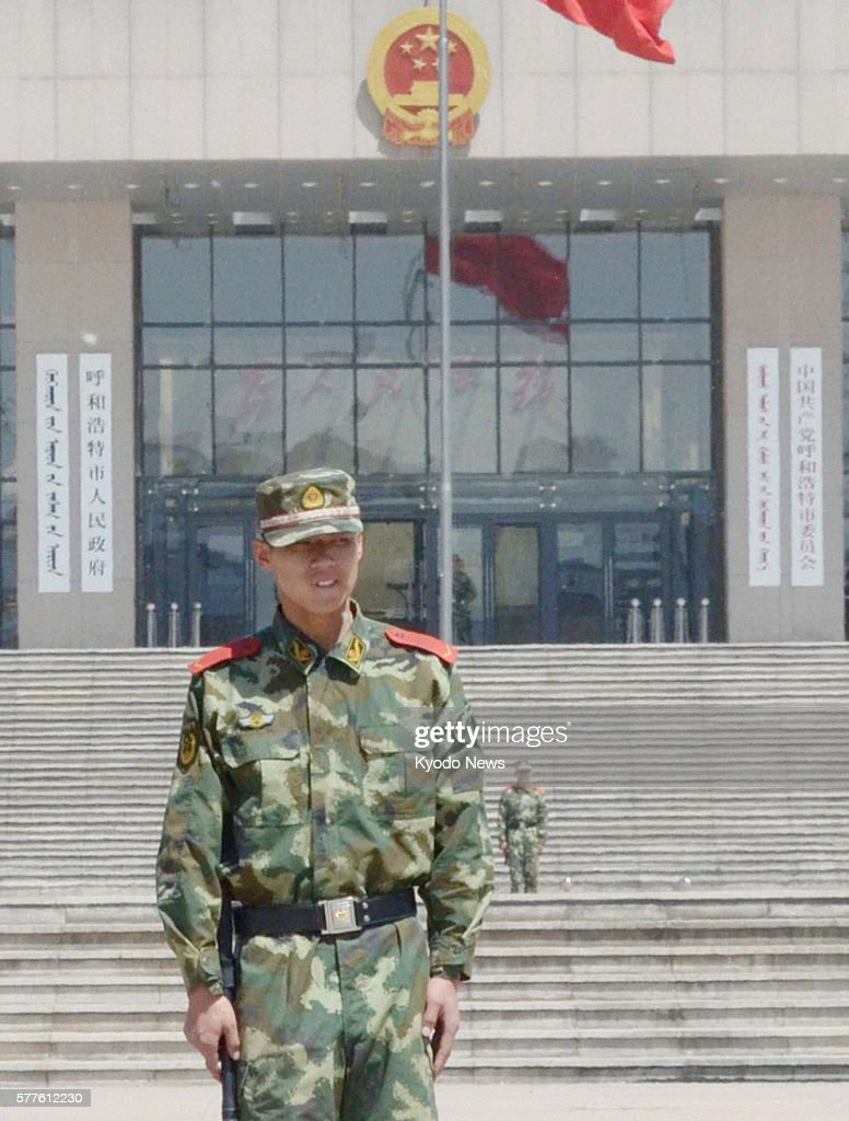 HOHHOT China An armed police officer guards the city hall building in Hohhot the capital of China's Inner Mongolian Autonomous Region on May 30 2011...