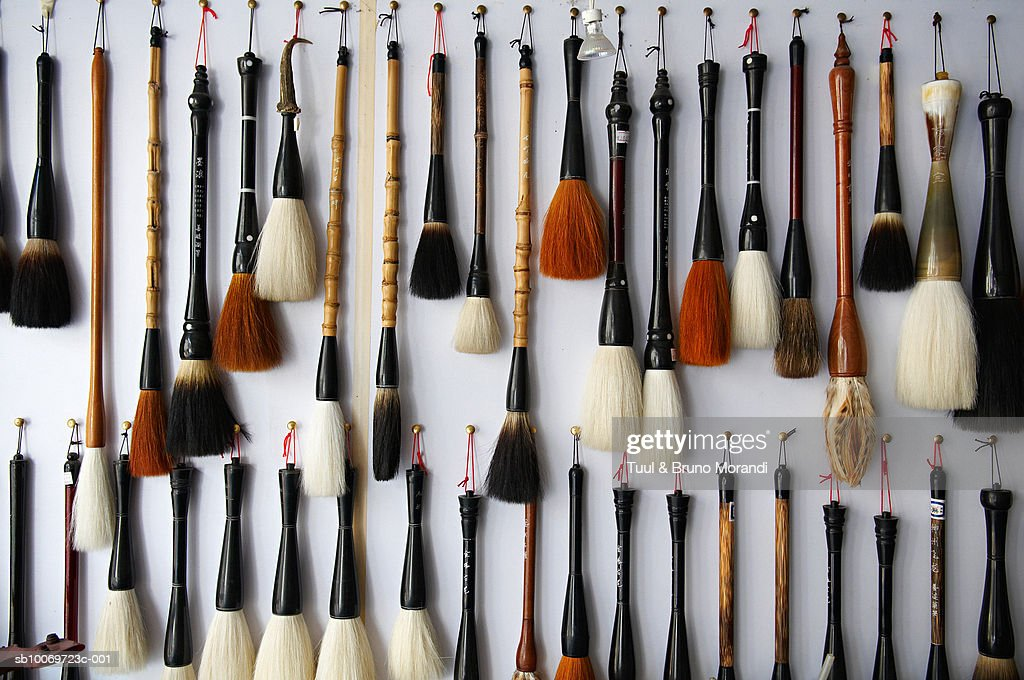 China, Anhui province, Tunxi, collection of brushes hanging on wall
