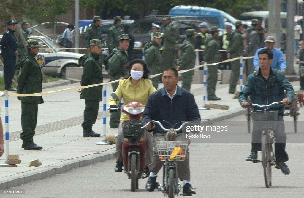 HOHHOT China Armed police officers blockade a square in Hohhot the capital of China's Inner Mongolian Autonomous Region on May 31 as there was a...