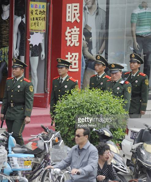 Xilinhot China  City pictures : XILINHOT China Armed police officers patrol in Xilinhot in China's ...