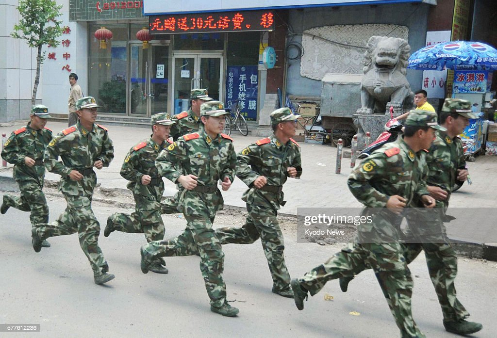 HOHHOT China Armed police officers run in an academic quarter of Hohhot the capital of China's Inner Mongolian Autonomous Region on May 30 2011...