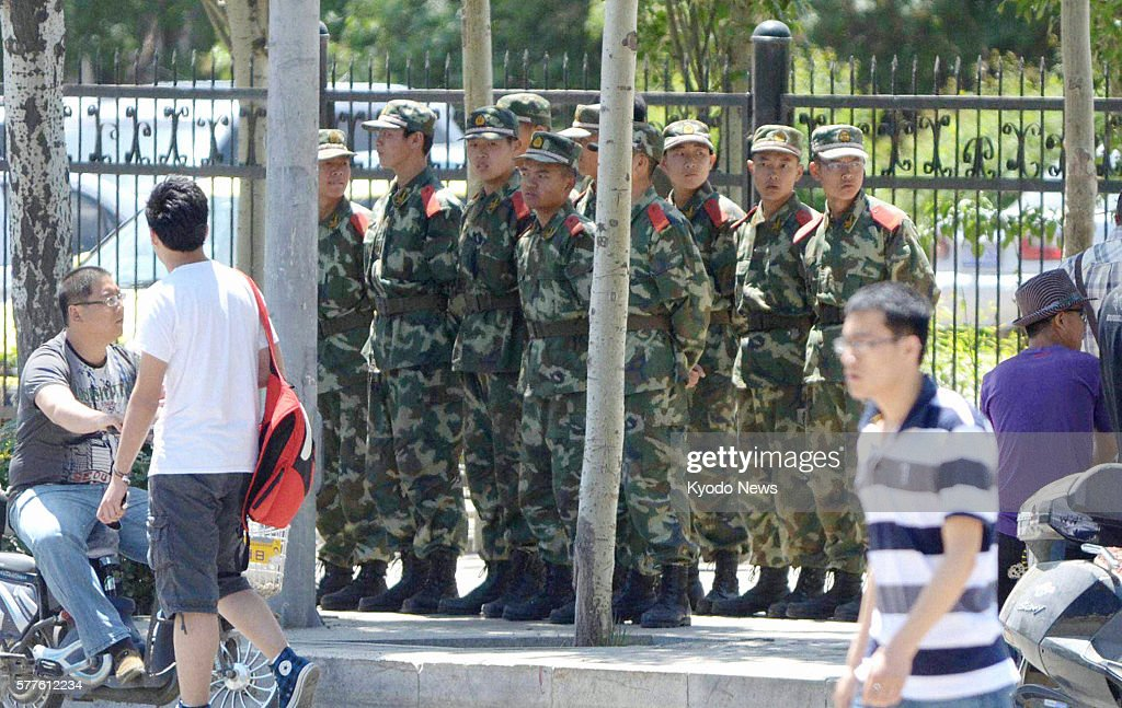HOHHOT China Armed police officers watch students in an academic quarter of Hohhot the capital of China's Inner Mongolian Autonomous Region on May 30...
