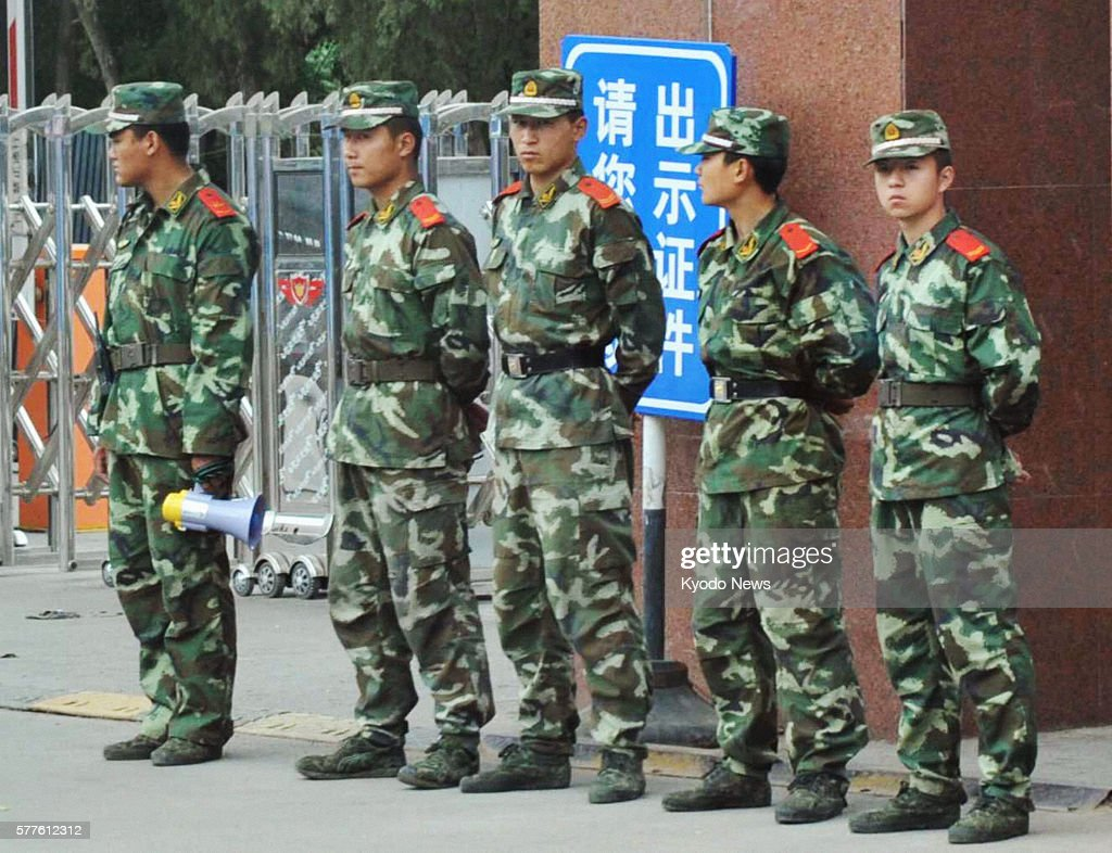 HOHHOT China Armed police officers watch students in front of Inner Mongolia Normal University in Hohhot the capital of China's Inner Mongolian...
