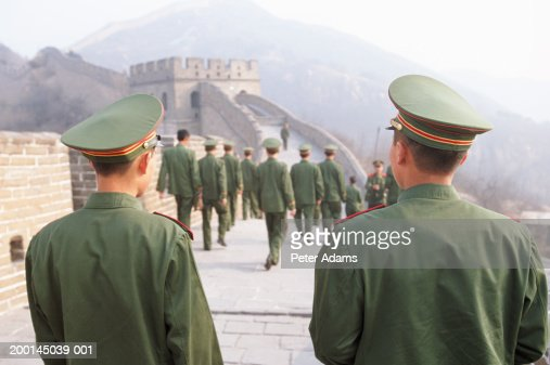 China, Badaling, soldiers on the Great Wall of China, rear view