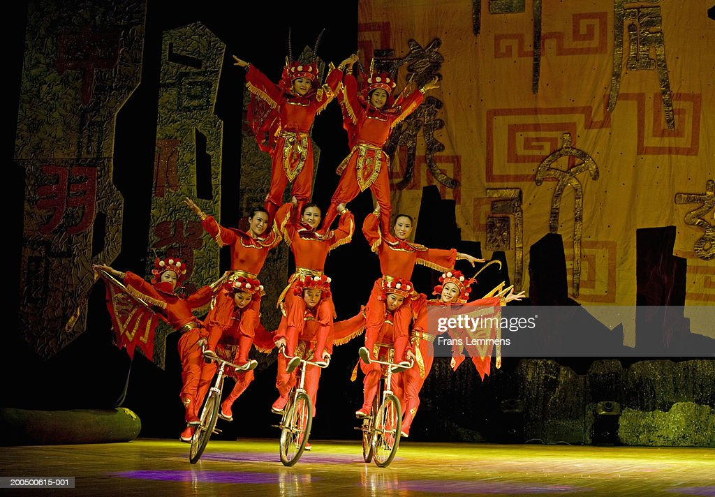 China, Beijing, Chaoyang Theatre, acrobats performing on bicycles : Stock Photo