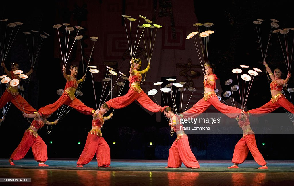 China, Beijing, Chaoyang Theatre, acrobats performing on stage : Stock Photo
