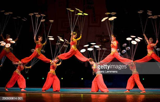 China, Beijing, Chaoyang Theatre, acrobats performing on stage