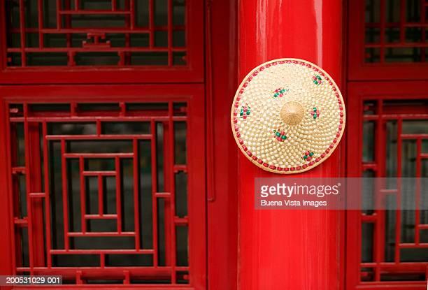 China, Beijing, Forbidden City, straw hat on pillar