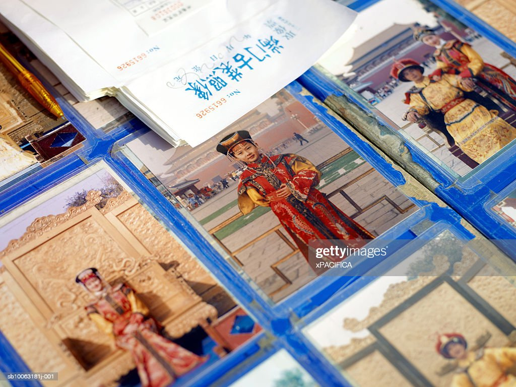 China, Beijing, postcards with people in traditional costumes : Stock Photo