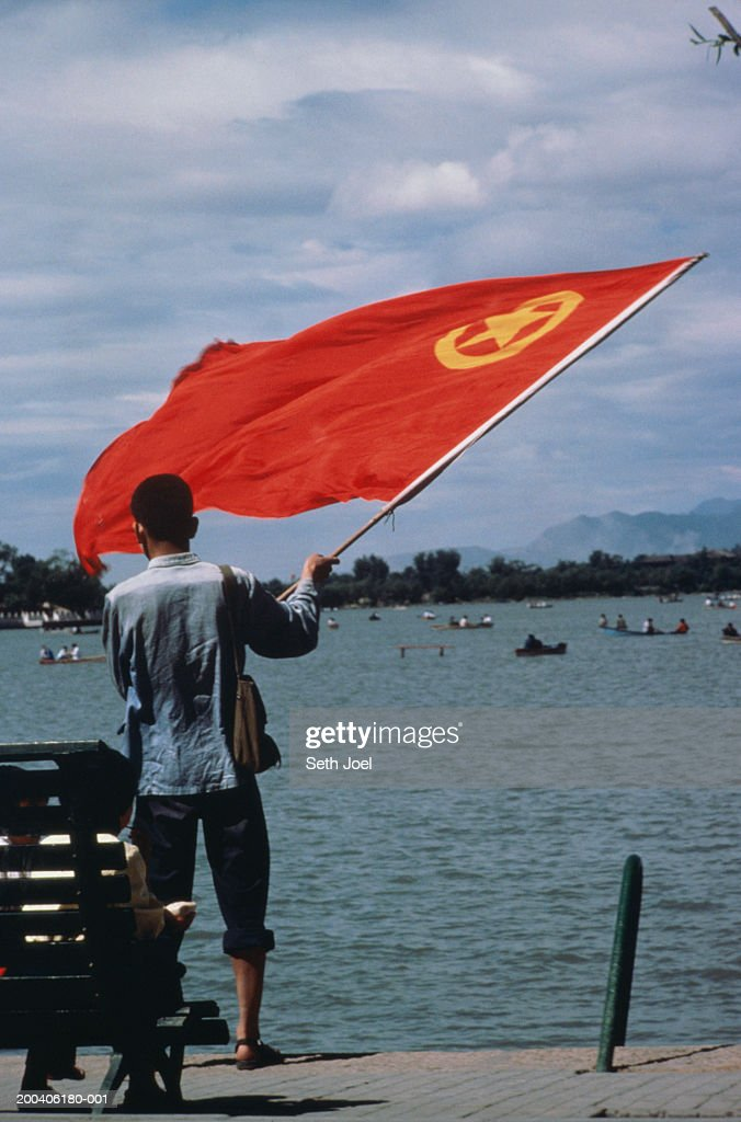 China, Beijing, Summer Palace, man waving flag, rear view : Stock Photo