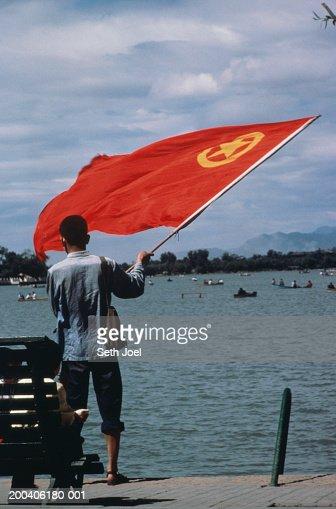 China, Beijing, Summer Palace, man waving flag, rear view : ストックフォト