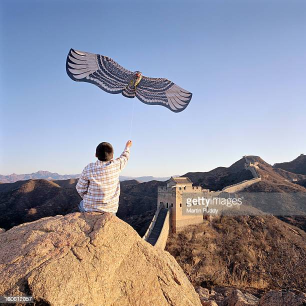 China, Beijing, the great wall, boy flying kite