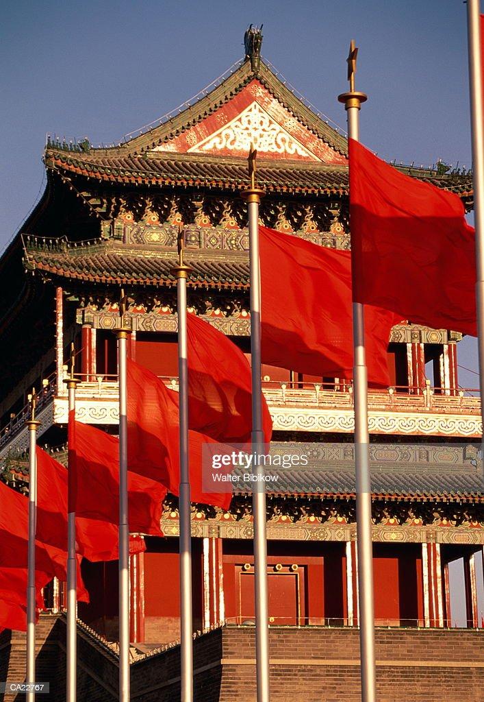 China, Beijing, Tiananmen Square, Zhongyang Tower, flags in foreground : Stock Photo