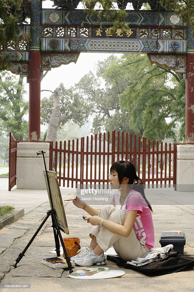 China, Beijing, young woman painting in botanical garden : Stock Photo