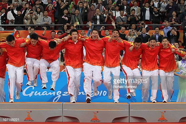 China celebrates winning the gold medal after defeating South Korea 7771 in the men's gold medal basketball game at the Guangzhou International...