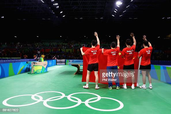 China celebrates winning the Men's Table Tennis gold medal match against Japan at Riocentro Pavilion 3 on Day 12 of the Rio 2016 Olympic Games on...
