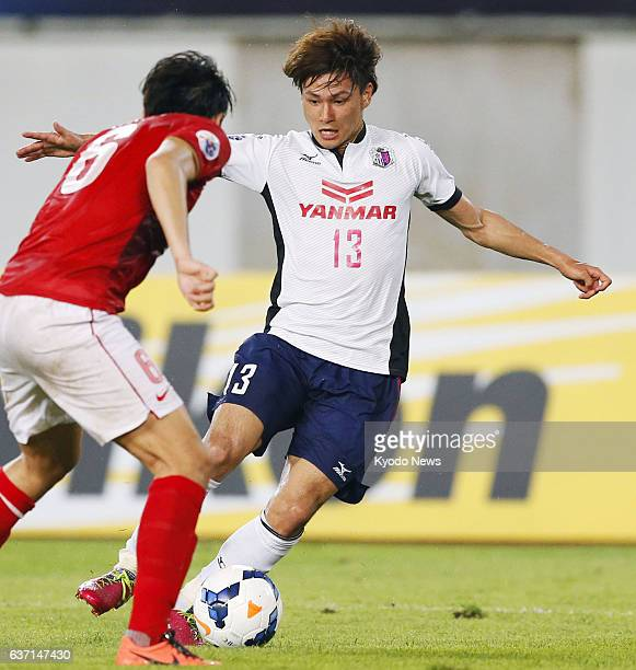 GUANGZHOU China Cerezo Osaka's Takumi Minamino tries to dodge Feng Xiaoting during an Asian Champions League match against China's Guangzhou...