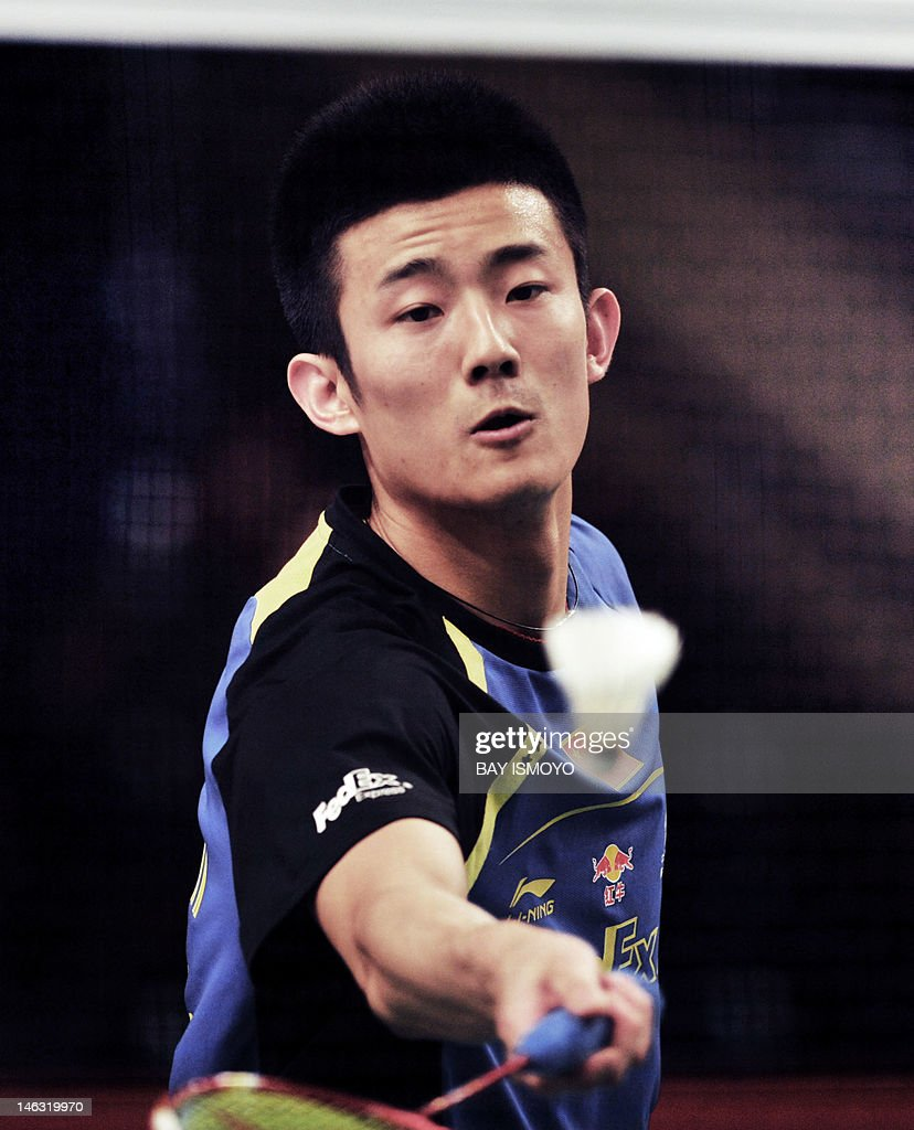 China Chen Long returns the shuttle cock