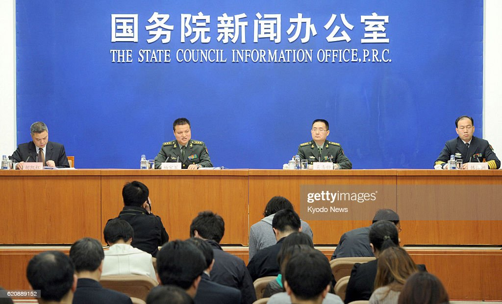 BEIJING, China - Chinese Defense Ministry spokesman Yang Yujun (2nd from L) and other officials hold a press conference in Beijing on April 16, 2013, upon the release of the country's defense white paper.
