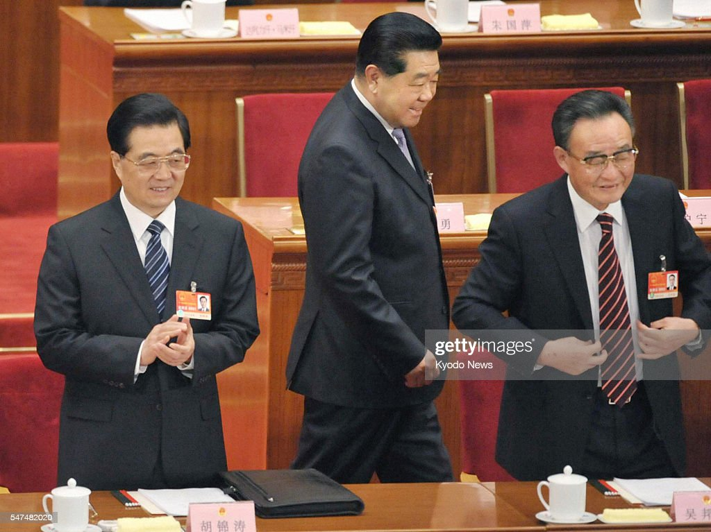 BEIJING China Chinese President Hu Jintao and Wu Bangguo chairman of the Standing Committee of the National People's Congress rise during an NPC...