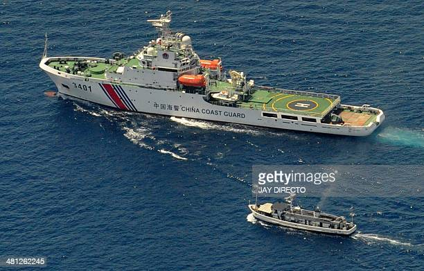 A China Coast Guard ship and a Philippine supply boat engage in a stand off as the Philippine boat attempts to reach the Second Thomas Shoal a remote...