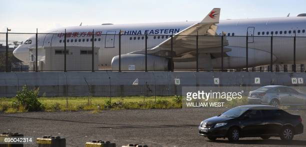 A China Eastern Airbus A330 passenger aircraft which suffered a serious fault to its starboard engine following takeoff sits on the tarmac at Sydney...