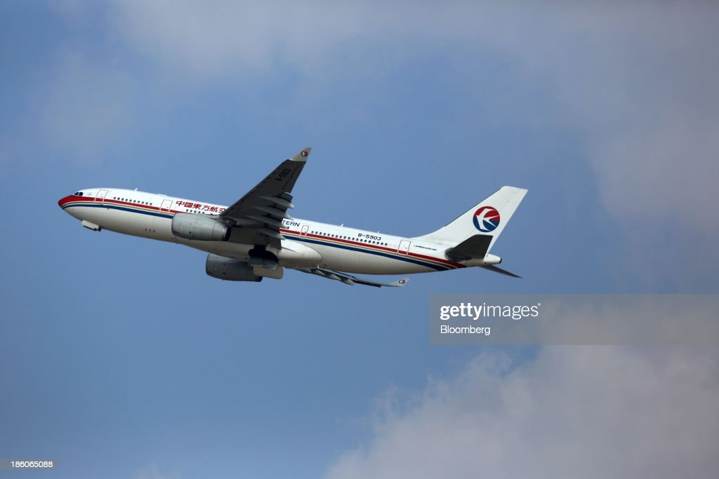 A China Eastern Airlines Corp. aircraft takes off at Shanghai Pudong International Airport in Shanghai, China, on Saturday, Oct. 26, 2013. Airline profits worldwide in 2013 will be 7.9 percent smaller than estimated at $11.7 billion amid sluggish travel demand and rising oil prices tied to the Syria crisis, the International Air Transport Association said last month. Photographer: Tomohiro Ohsumi/Bloomberg via Getty Images