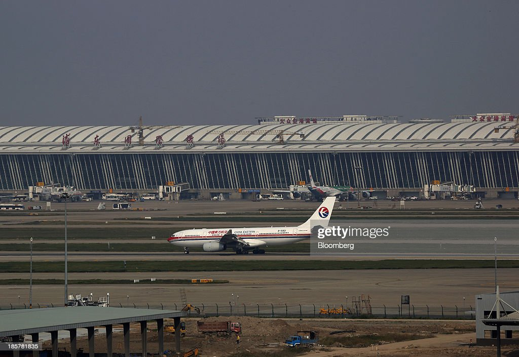 A China Eastern Airlines Corp. airplane taxiing at Shanghai Pudong International Airport is seen from an observation deck in China (Shanghai) Pilot Free Trade Zone's Pudong free trade zone in Shanghai, China, on Thursday, Oct. 24, 2013. The area is a testing ground for free-market policies that Premier Li Keqiang has signaled he may later implement more broadly in the world's second-largest economy. Photographer: Tomohiro Ohsumi/Bloomberg via Getty Images