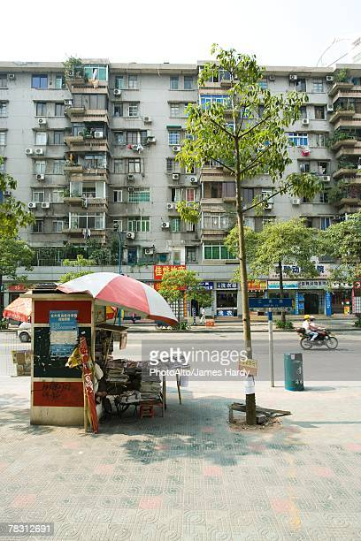 China, Guangdong Province, Guangzhou, newspaper stand