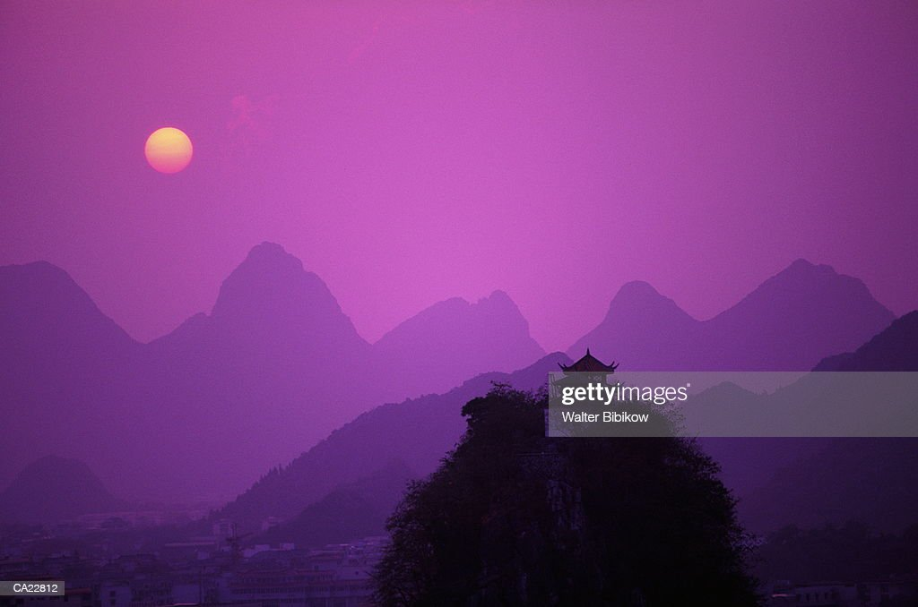 China, Guangxi Province, Guilin, mountains at sunset, silhouette : Stock Photo